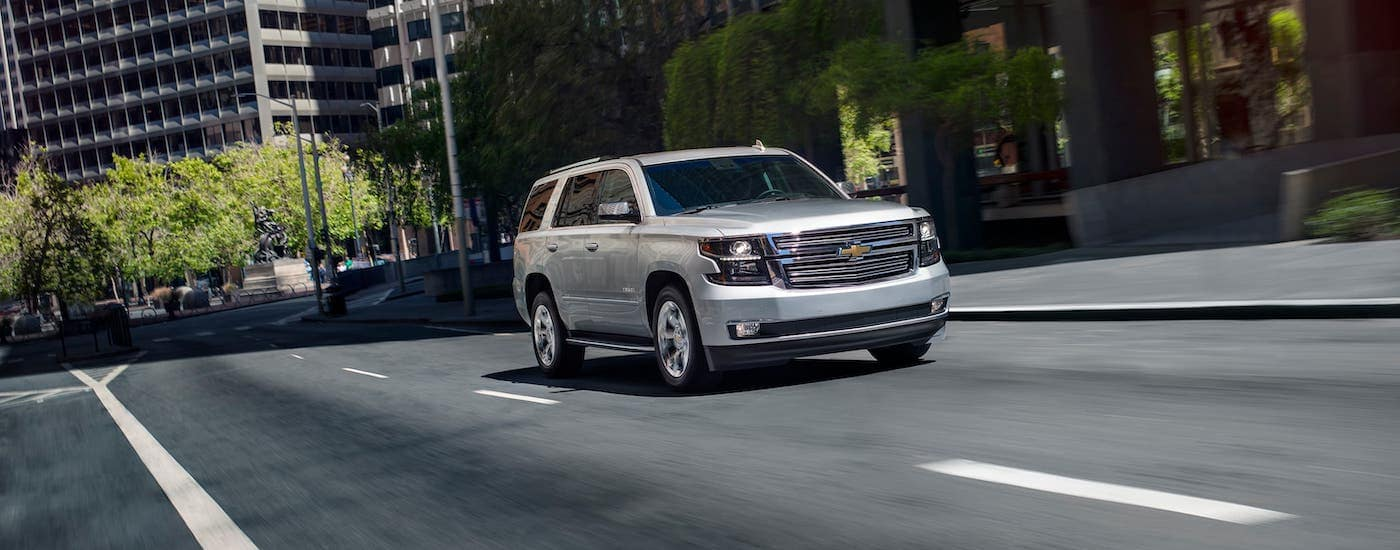 A silver 2020 Chevy Tahoe is driving on a street near Buford, GA.