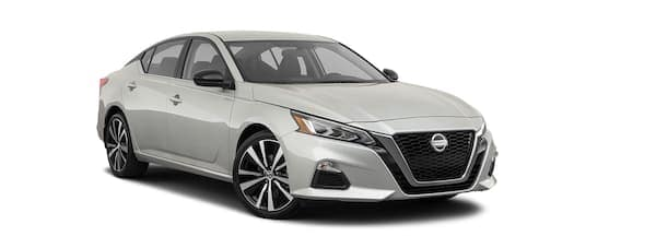 A silver 2020 Nissan Altima is facing right.