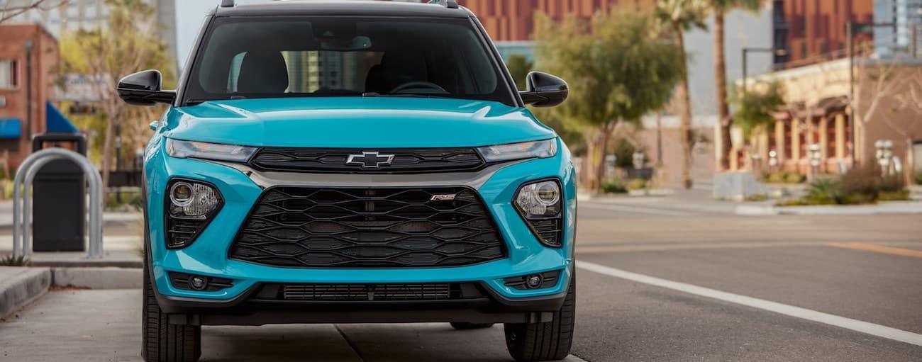 A teal blue 2021 Chevy Trailblazer is parked on a city street near Buford, GA.