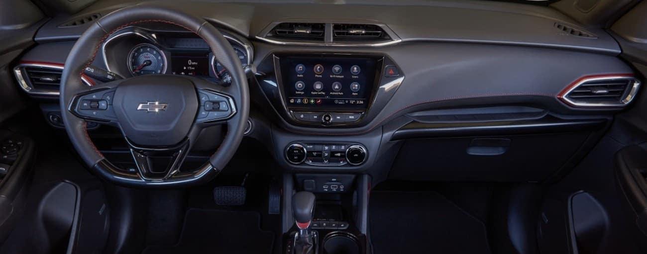 The black interior of a 2021 Chevy Trailblazer is shown.