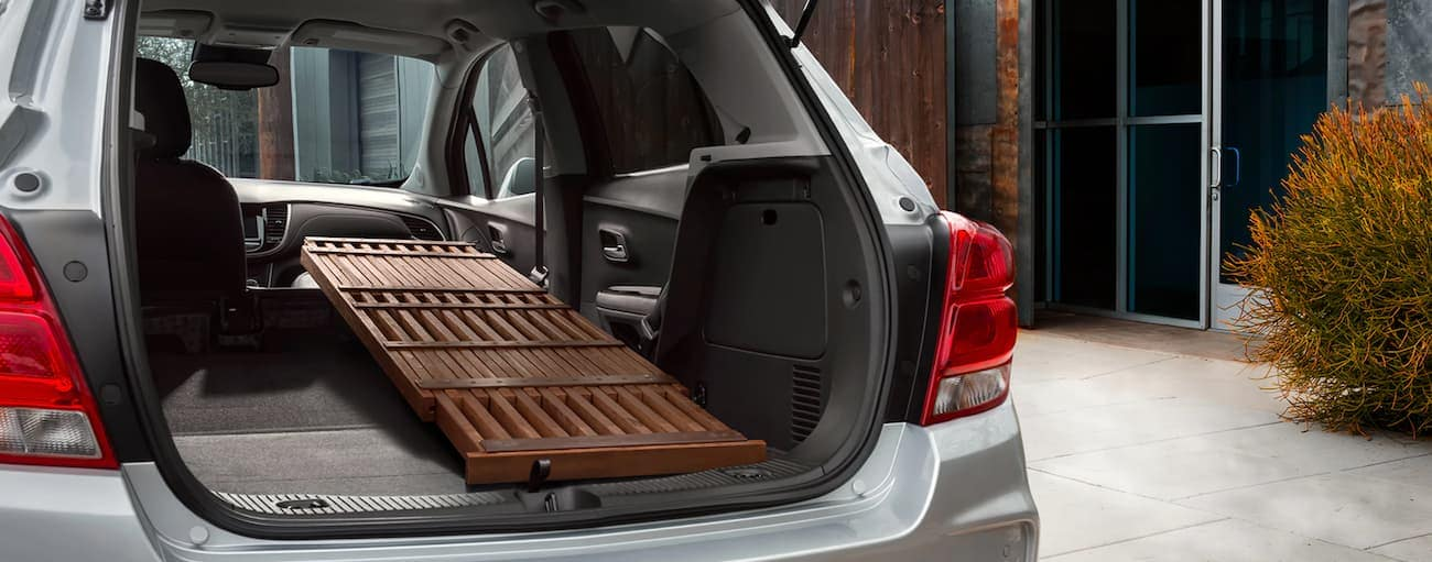 A table is folded up in the cargo area of a Chevy Trax.