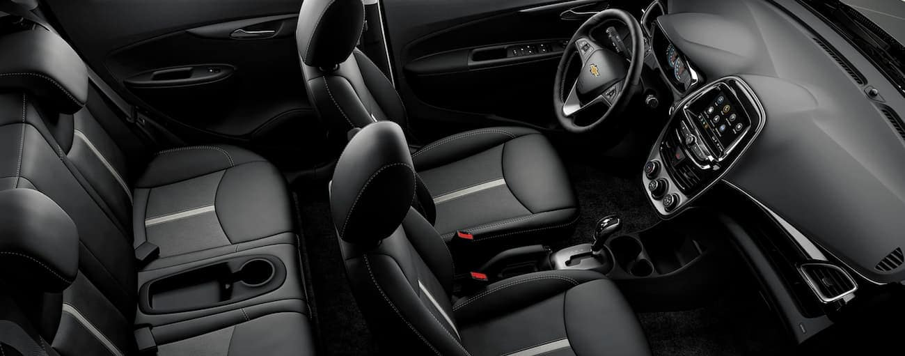 The black interior of a 2021 Chevy Spark is shown from above.
