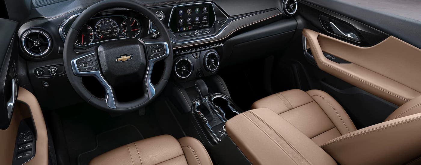 The tan seats and black interior of a 2021 Chevy Blazer are shown from above.