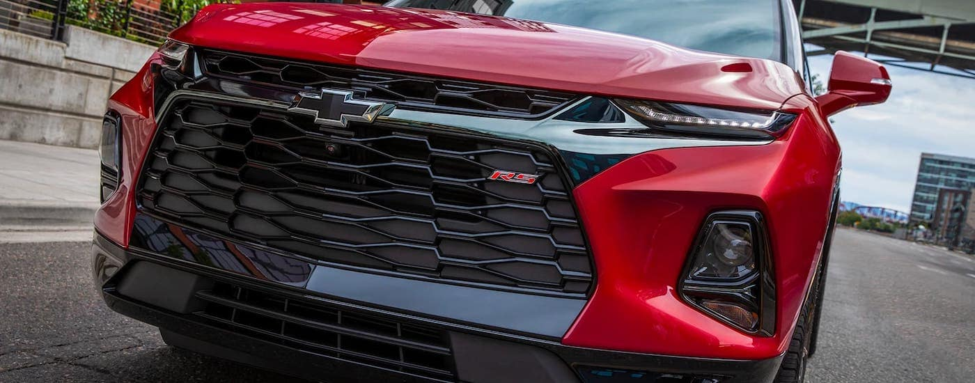 A closeup shows the grille on a red 2021 Chevy Blazer RS.