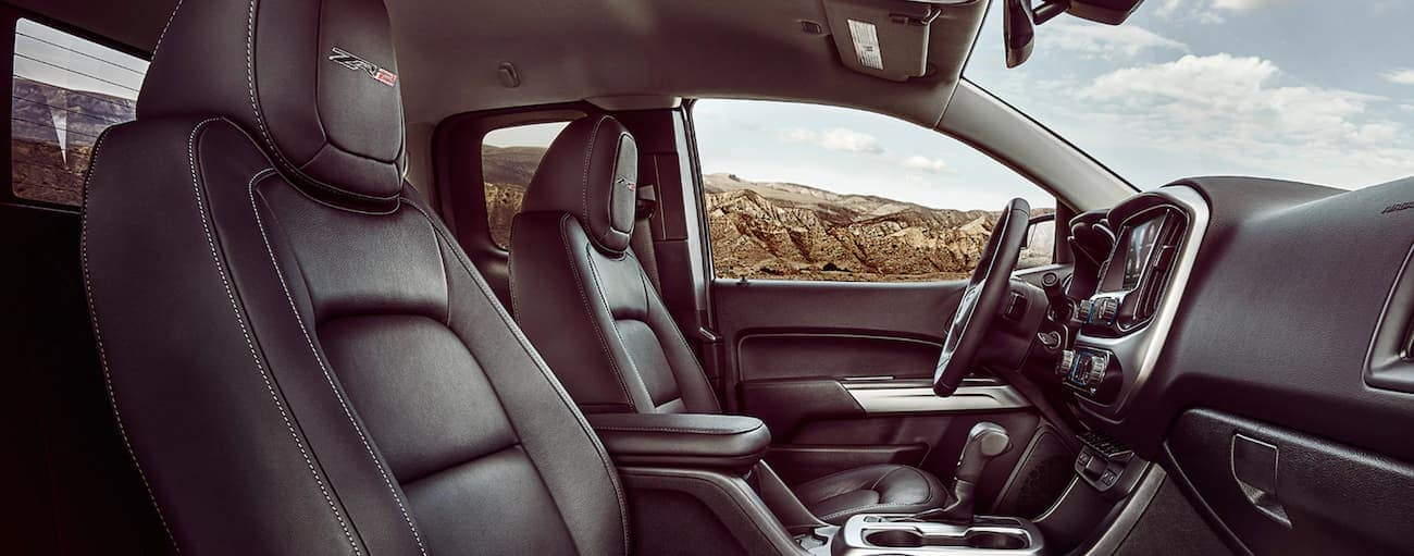 The black interior of a 2021 Chevy Colorado is shown from the side.