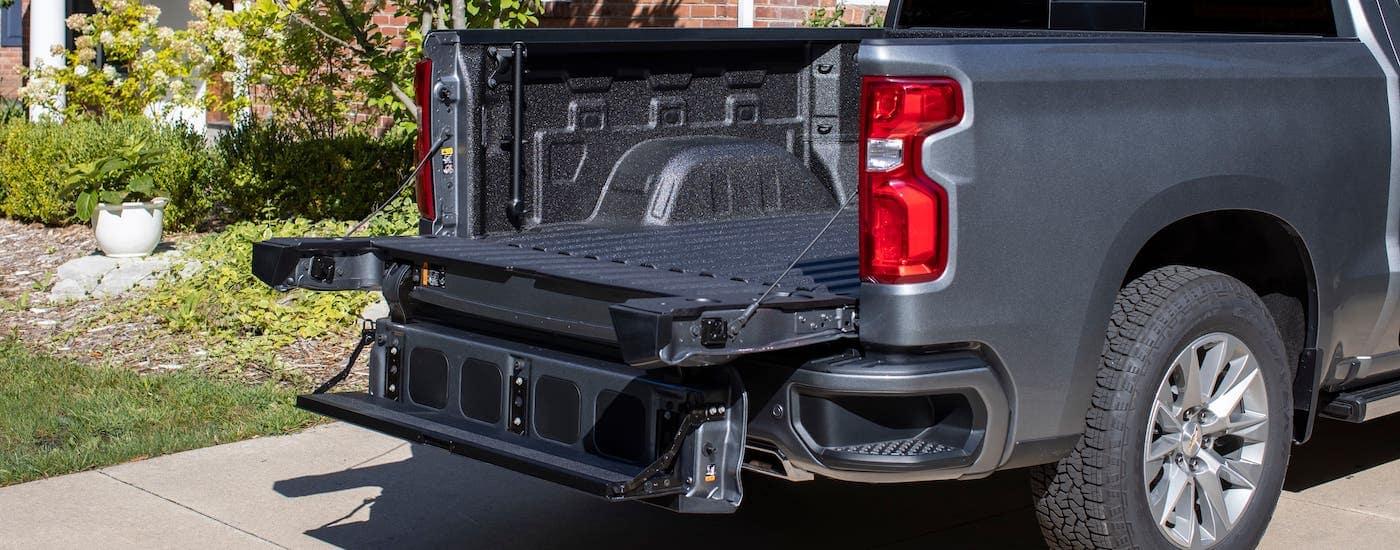 The Multi-Flex tailgate is open on a gray 2021 Chevy Silverado 1500.