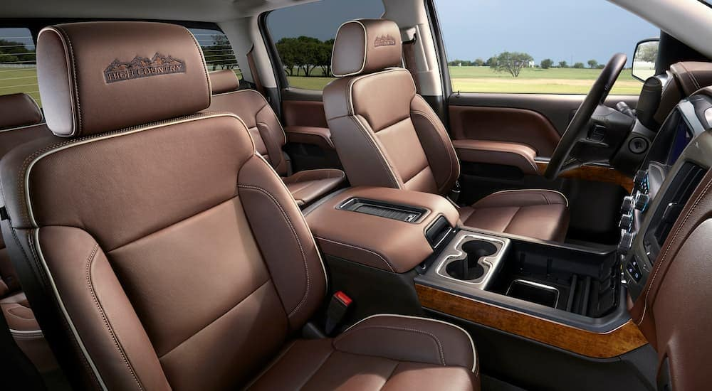 The brown interior is shown on a 2018 used Chevy Silverado High Country.