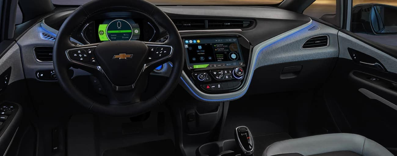 The black interior of a 2021 Chevy Bolt EV is shown.