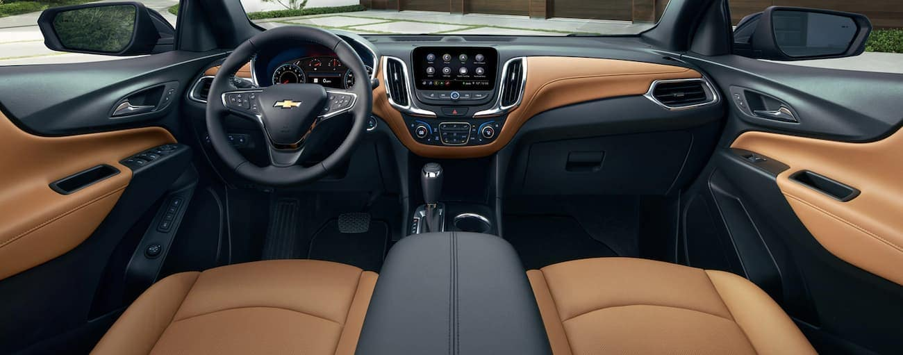 The brown and black interior of a 2021 Chevy Equinox is shown.