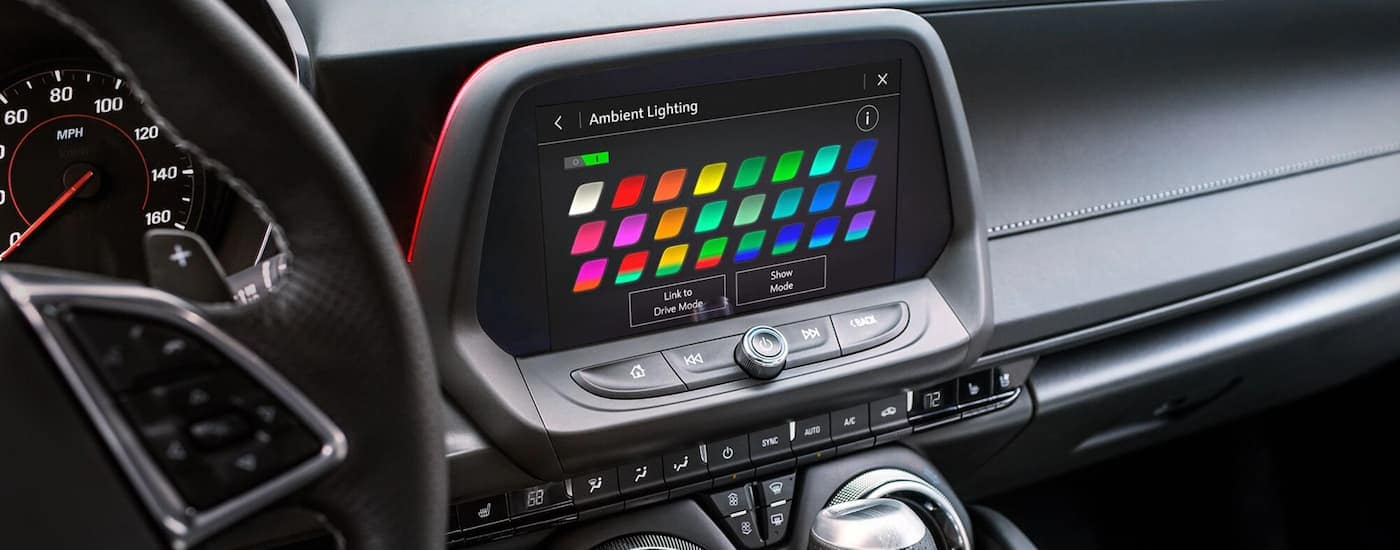 A close up is shown of the infotainment screen showing ambient lighting options on a 2021 Chevy Camaro.