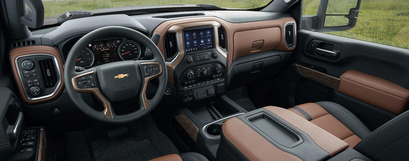 The black and brown interior is shown on a 2021 Chevy Silverado 2500 HD