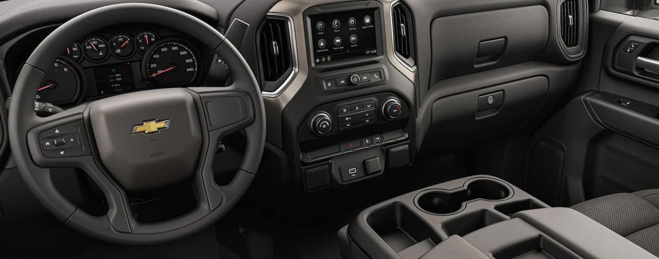 The wheel and dashboard in a 2021 Chevy Silverado 3500 HD Chassis Cab are shown.