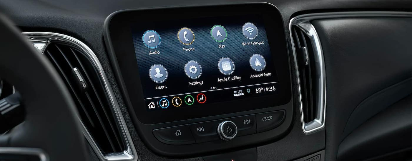A close up shows the apps on the infotainment screen in a 2021 Chevy Malibu.