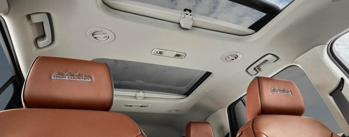 The tan interior and brown seats are shown from a low angle in the 2021 Chevy Traverse High Country.
