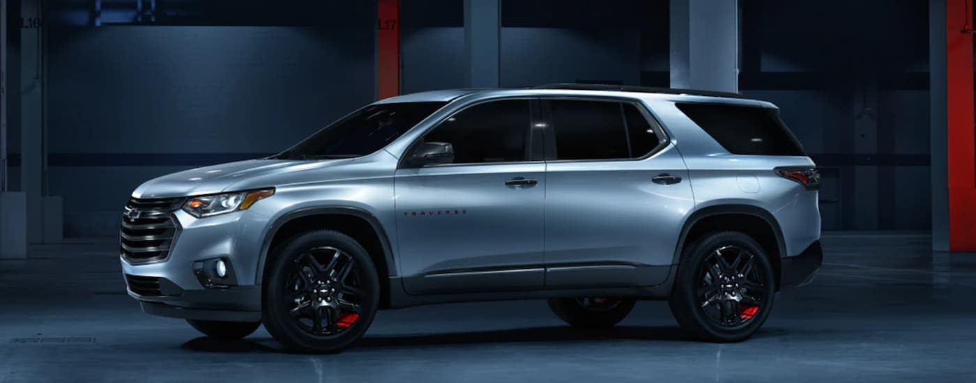 A silver 2021 Chevy Traverse Redline is shown from the side, parked in a futuristic space, after winning the 2021 Chevy Traverse vs 2021 Honda Pilot comparison.