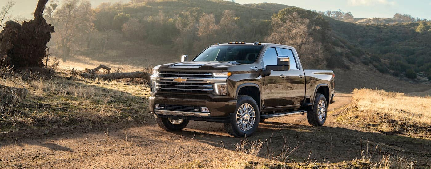 A black 2021 Chevy Silverado 2500 HD High Country is shown from the side after winning the 2021 Chevy Silverado 2500 HD vs 2021 Ram 2500 comparison.