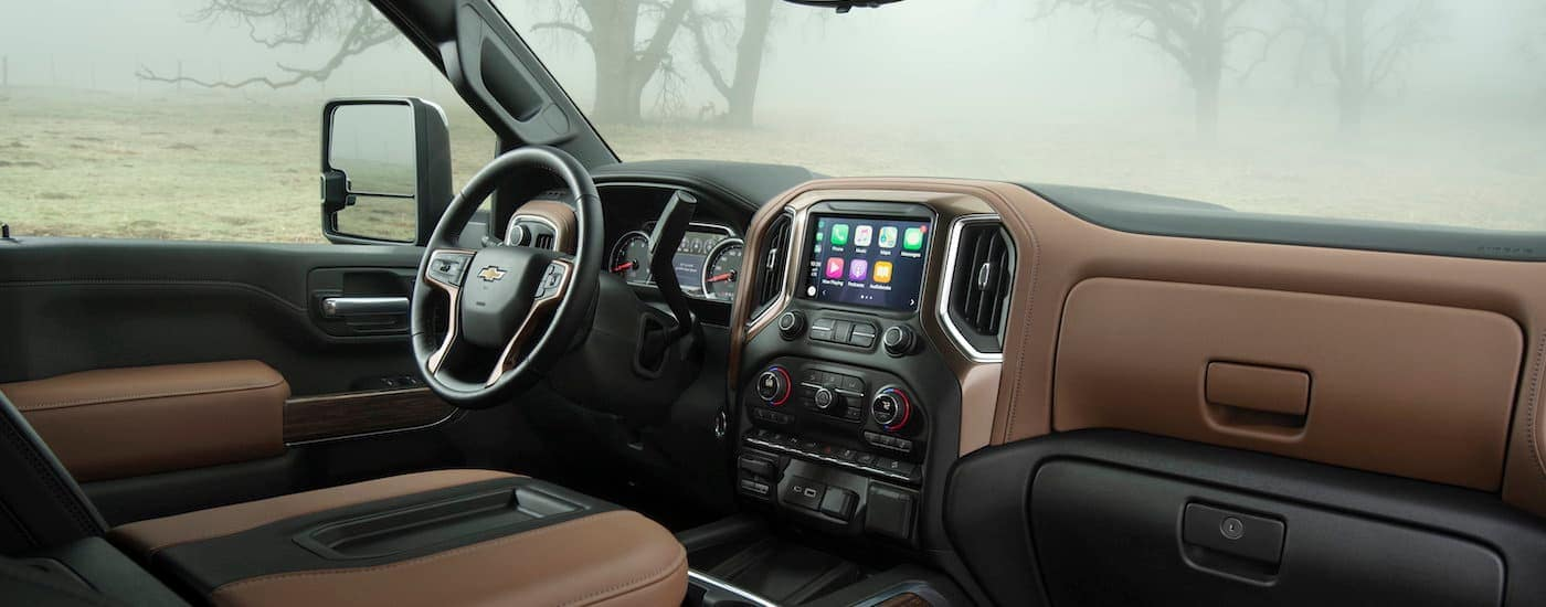 The brown and black interior is shown in a 2021 Chevy Silverado 2500 HD High Country.