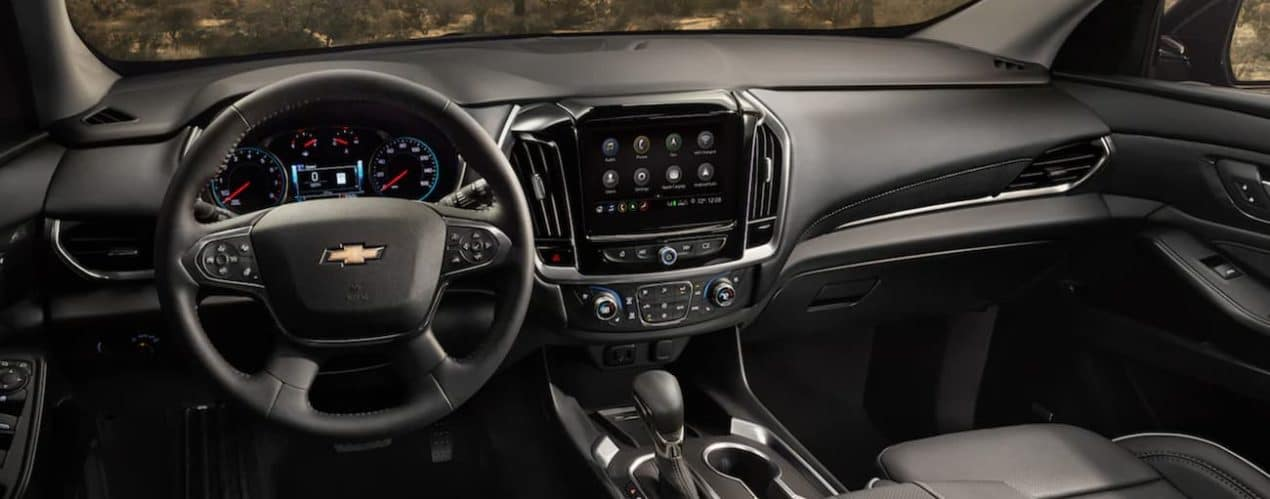 The steering wheel and screen are shown in a 2021 Chevy Traverse.
