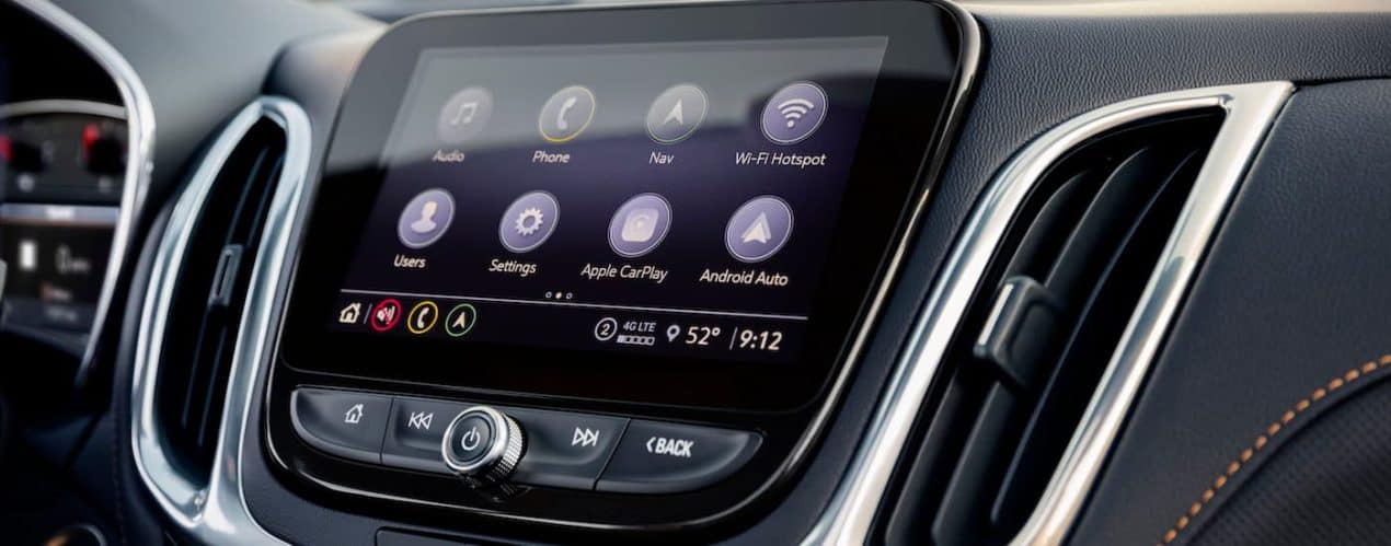 A close up shows the apps on the infotainment screen in a 2022 Chevy Equinox Premier.
