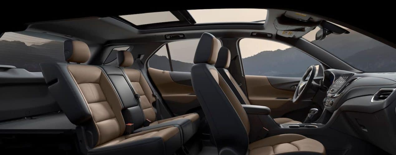 The black and brown interior seating is shown in a 2022 Chevy Equinox Premier.