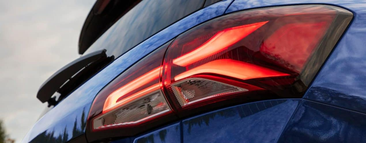 A close up shows the LED taillight on a blue 2022 Chevy Equinox Premier.