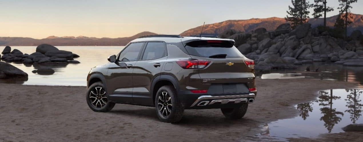 A brown 2022 Chevy Trailblazer Activ is shown from the rear parked on a lake shore.