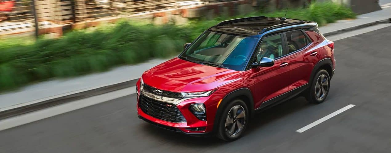 A red 2022 Chevy Trailblazer RS is shown from a high angle driving down a road.