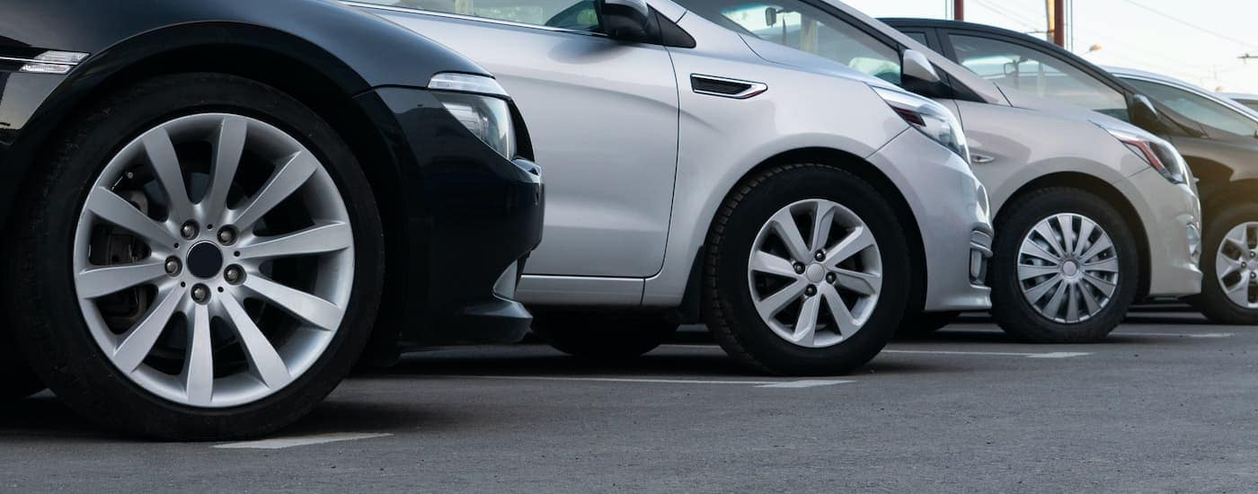 A row of cars are shown from a low angle at an Atlanta used Chevy dealer.