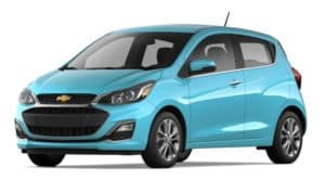 A turquoise 2022 Chevy Spark is shown angled left.