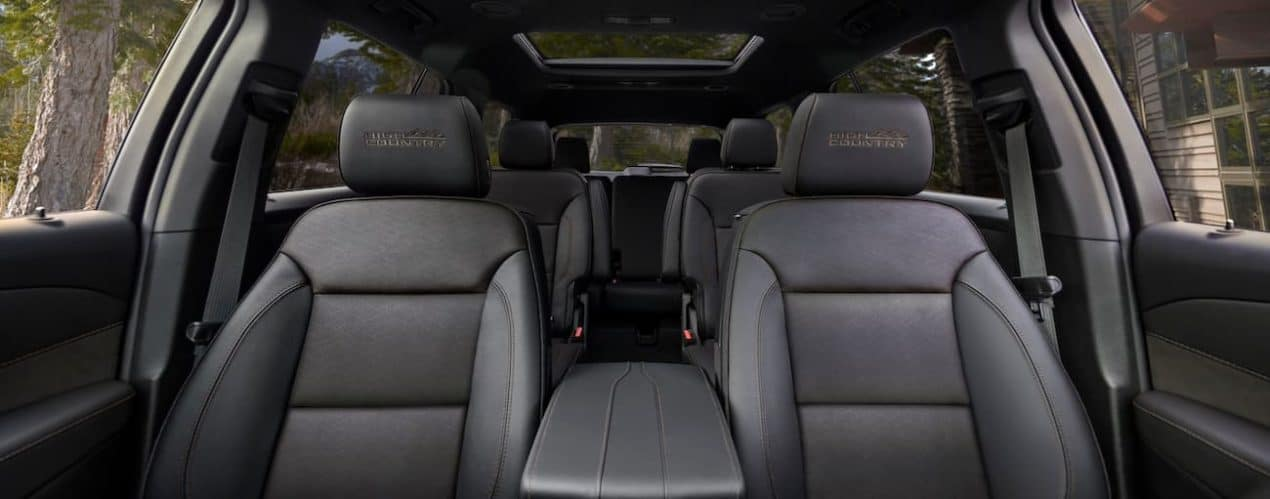 The black interior of a 2022 Chevy Traverse High Country shows three rows of seating.