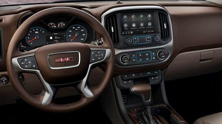 Interior photo of GMC dashboard with wheel and accessories