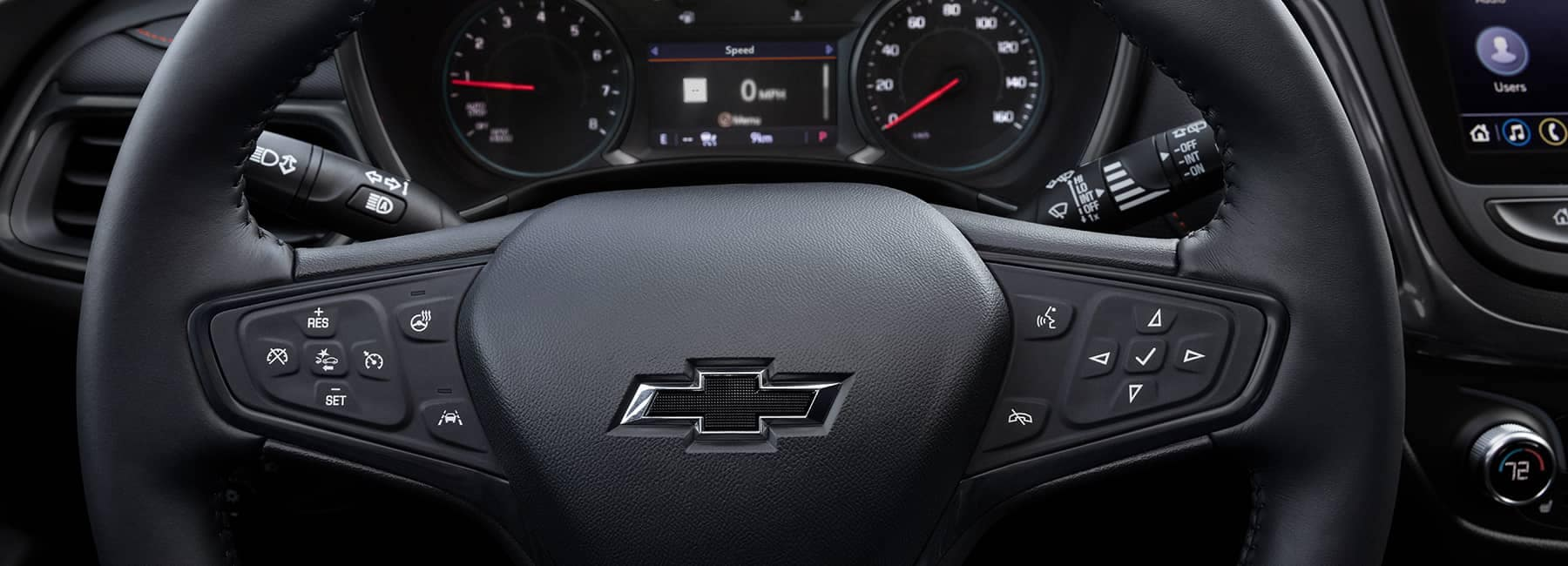 Interior photo of Chevrolet dashboard with wheel and accessories